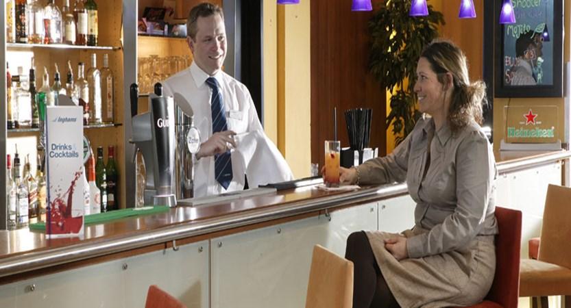 austria_st-christoph_chalet-hotel-st-christoph_bar-area-staff-guest.jpg