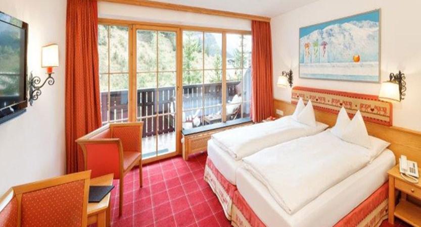 chesa-rosa-snow-white-twin-bedroom.jpg