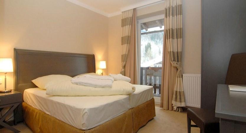 austria_st-johann_sporthotel-austria_bedroom.jpg