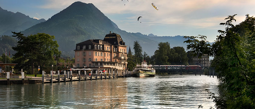 View of the Hotel Du Lac, exterior with paragliders up above.jpg