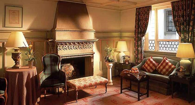 Hotel Wilden Mann, Lucerne, Switzerland - hotel lounge with fireplace.jpg