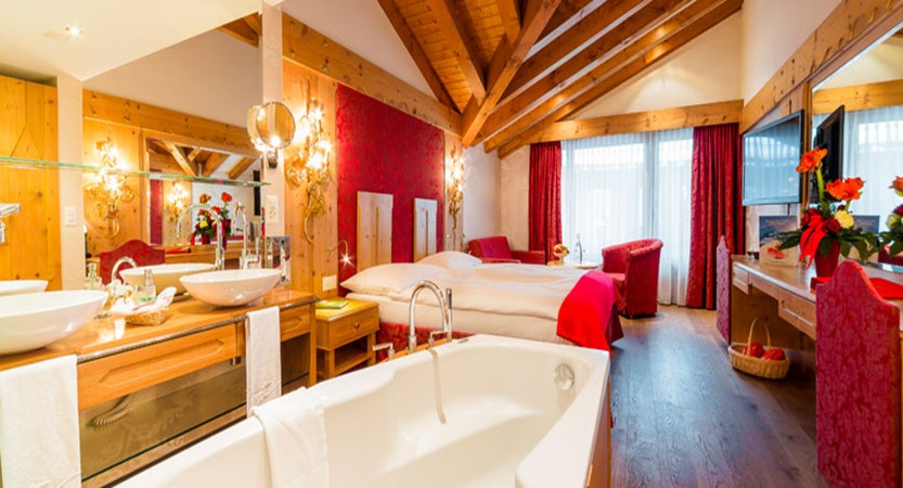 Hotel Ferienart Resort & Spa, Saas-Fee, Switzerland - Double bedroom with bath overview.jpg