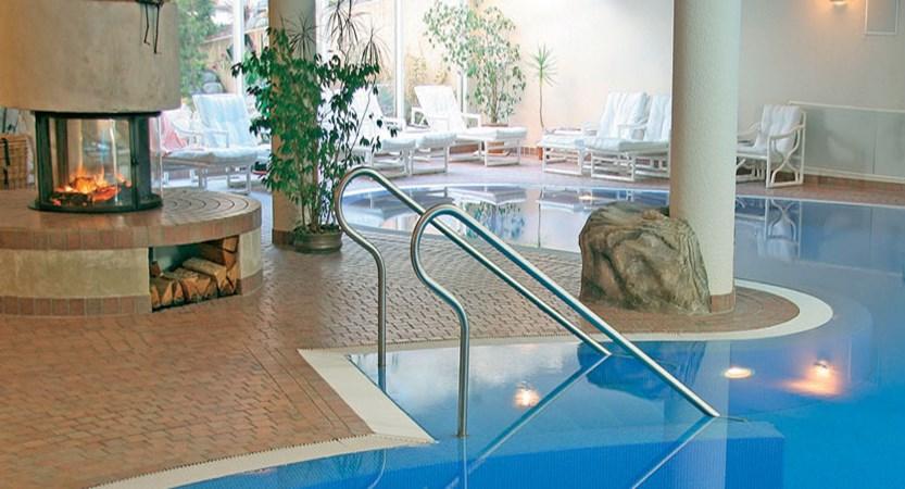 Hotel Ferienart Resort & Spa, Saas-Fee, Switzerland - indoor pool and fireplace.jpg