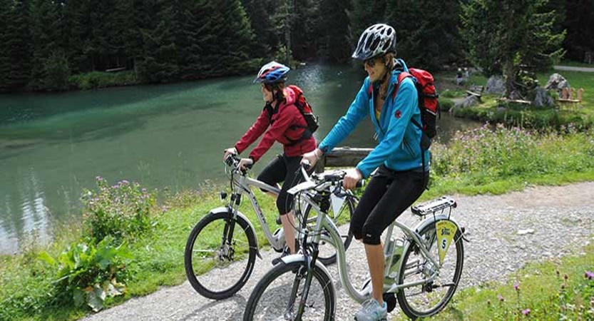 Filzmoos, Austria - Cyclists by the lake.jpg