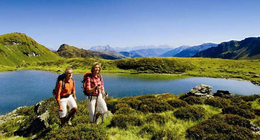 Saalbach & Hinterglemm, Austria, Hikers by the lake.jpg