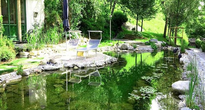 Gardenhotel Theresia, Hinterglemm, Austria - Garden with lake.jpg