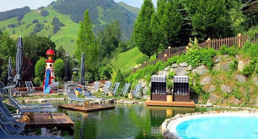 Gardenhotel Theresia, Hinterglemm, Austria - Outdoor pool & relaxation area.jpg