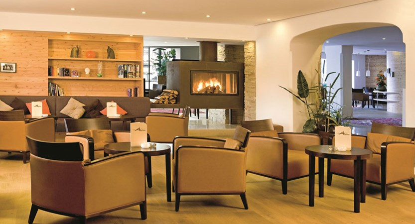 Hotel Bon Alpina, Igls, Austria - Lounge area with open fire place.jpg