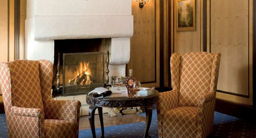 Hotel Schloss Lebenberg, Kitzbühel, Austria - Lounge area with open fire place.jpg