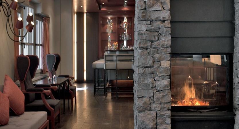 Schwarzer Adler, Kitzbühel, Austria - lounge with fireplace.jpg