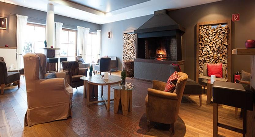 Q Resort Health & Spa, Kitzbühel, Austria - lounge with fireplace.jpg
