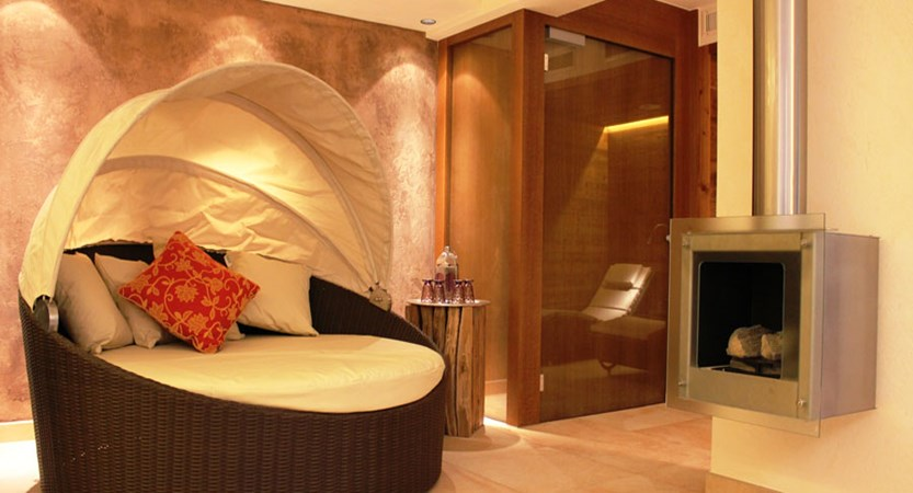 Hotel Haldenhof, Lech, Austria - Relaxation area with fire place.jpg
