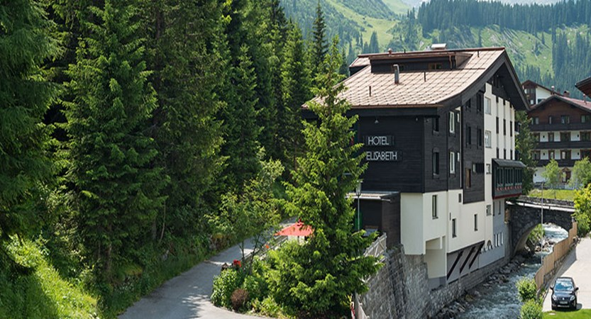 View of Chalet Hotel Elisabeth by the river.jpg