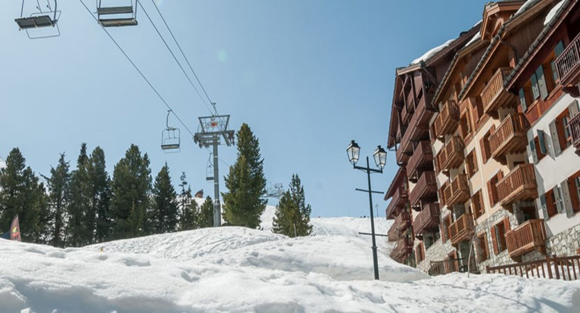France_Les-Arcs_Le-Village-Apartments_Exterior-winter-chairlifts.jpg