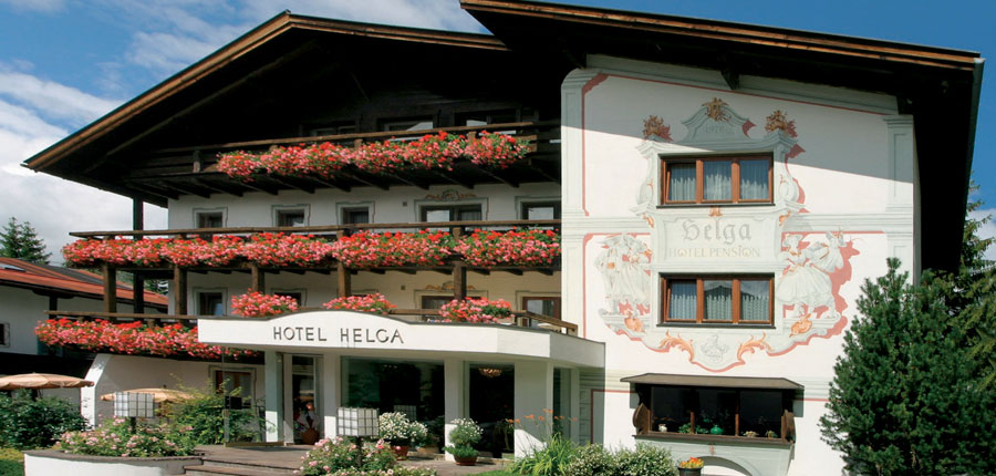 Hotel Helga, Seefeld, Austria - Hotel exterior with red flowers on the balconies..jpg