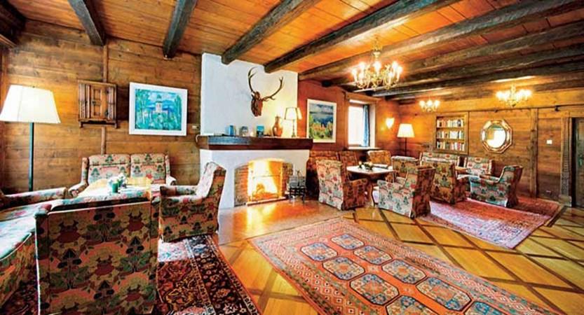 Hotel Karwendelhof, Seefeld, Austria - Wood-panelled lounge with open fire place.jpg