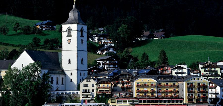 Romantik Hotel Weisses Rössl, St. Wolfgang, Salzkammergut, Austria - Hotel exterior with the church..jpg