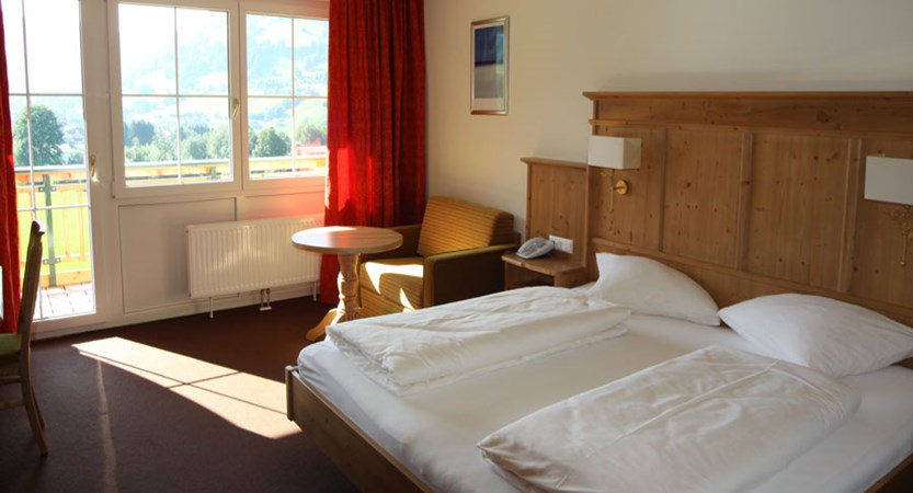 Hotel Harfenwirt, Niederau, The Wildschönau Valley, Austria - Bedroom interior.jpg