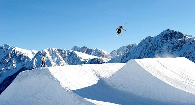 italy_the-dolomites-ski-area_kronplatz_skier-jump-action.jpg