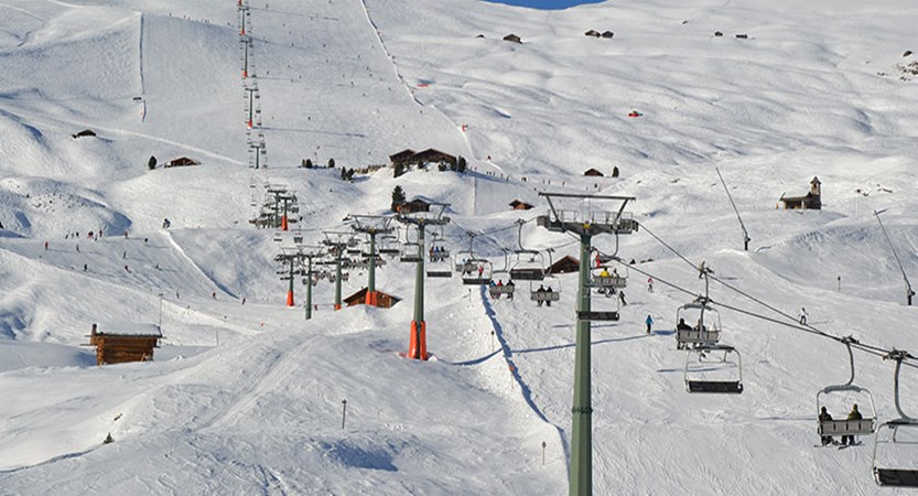 Italy_The-Dolomites-Ski-Area_Selva_Chairlift-view.jpg