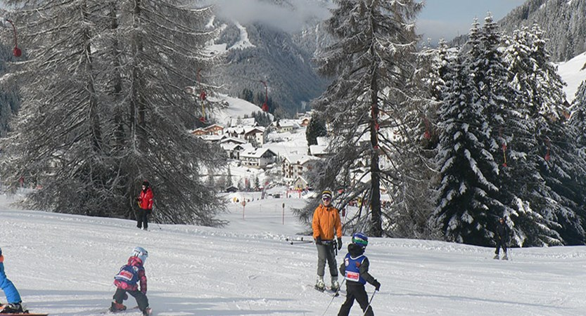 Italy_The-Dolomites-Ski-Area_Selva_Skiers-resort-trees.jpg