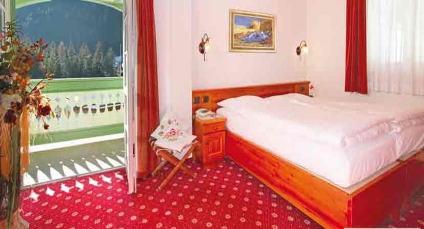 italy_dolomites_canazei_hotel-dolomiti_classic-bedroom.jpg