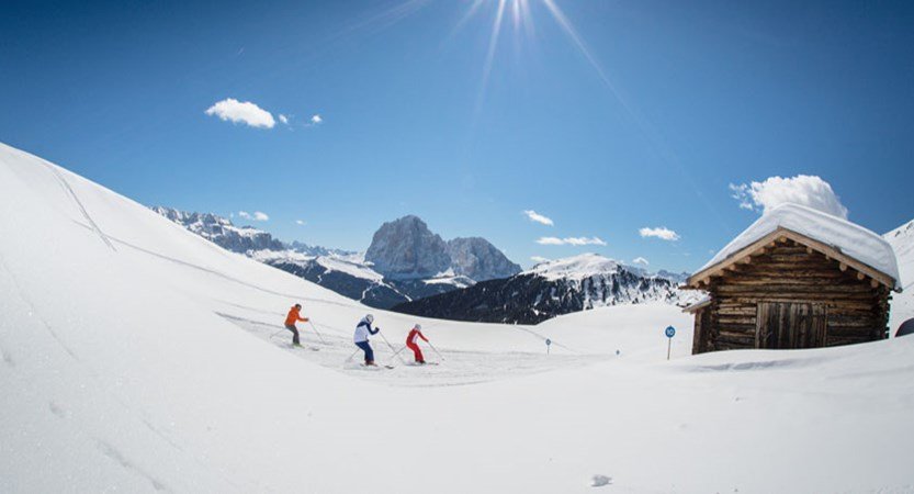 Italy_The-Dolomites-Ski-Area_Skiers-hut-sunshine.jpg