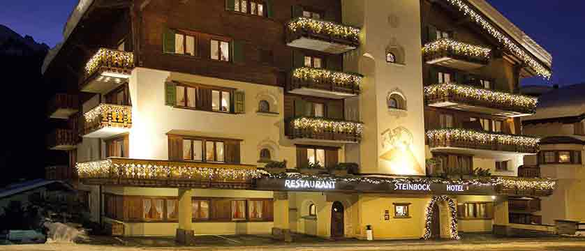 switzerland_klosters_hotel-steinbock_exterior-at-night.jpg