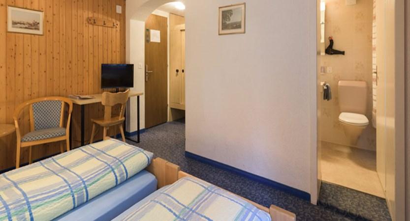 Switzerland_Grindelwald_Hotel-Jungfrau-lodge_Main-building-bedroom.jpg