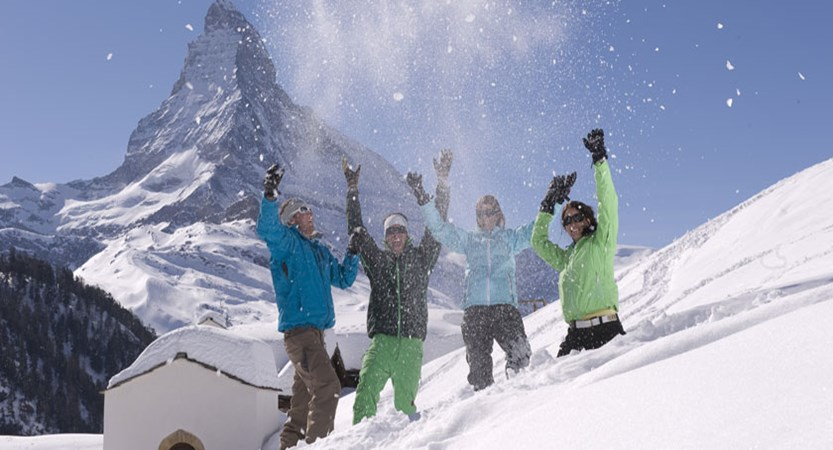 Switzerland_Zermatt_Couples-playing-snow.jpg