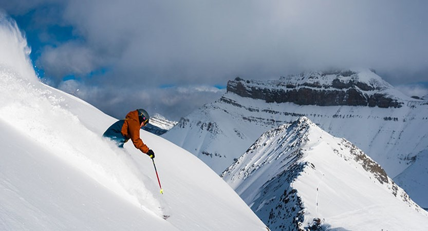 skier-in-lake-louise-with-mountain-in-background.jpg