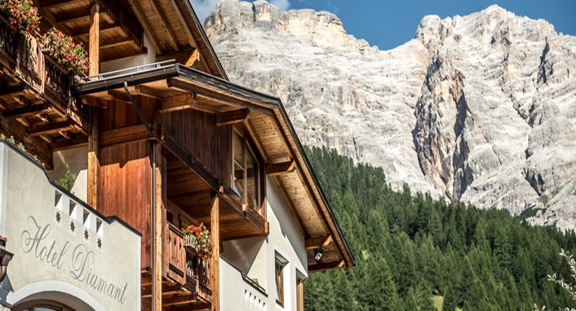 Hotel Diamant, San Cassiano, Italy - Exterior with mountains.jpg