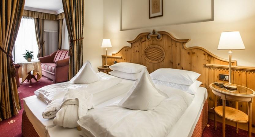 italy_dolomites_la_villa_hotel_christiania_deluxe_bedroom.jpg