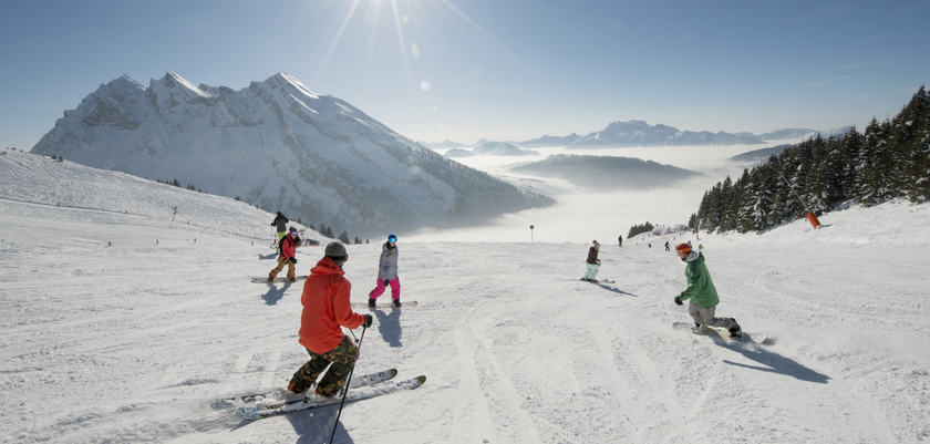 Skiers above the clouds