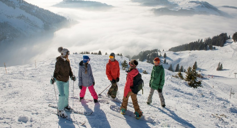 A group of skiers above the clouds