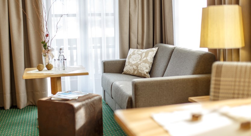 Typical larger twin bedroom with  lounge area HELDS vitalhotel