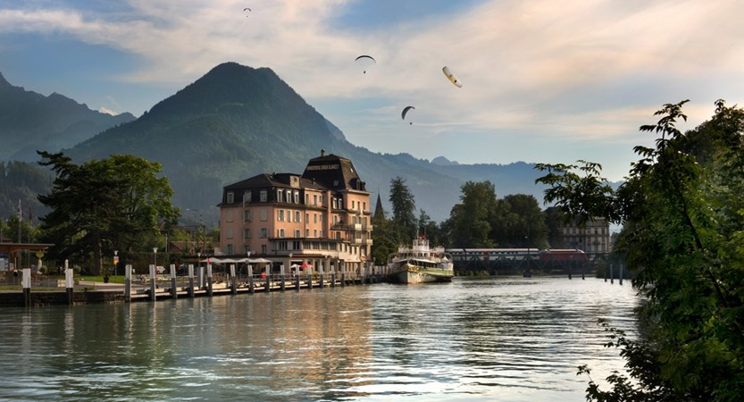 View of the Hotel Du Lac, exterior with paragliders up abovea.jpg