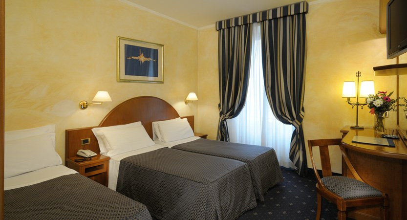 Al-Manthia-Hotel-Bedroom-Family-room.jpg