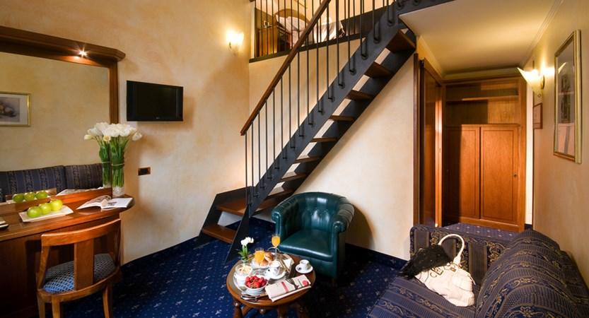 Al-Manthia-Hotel-Bedroom.jpg