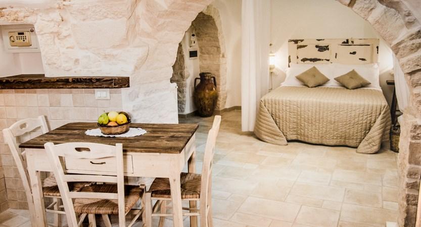 Trulli-Houses-Bedroom-Dining.jpg