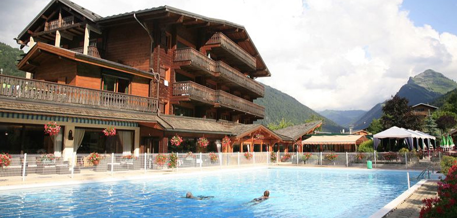 Hotel Le Cret exterior with pool